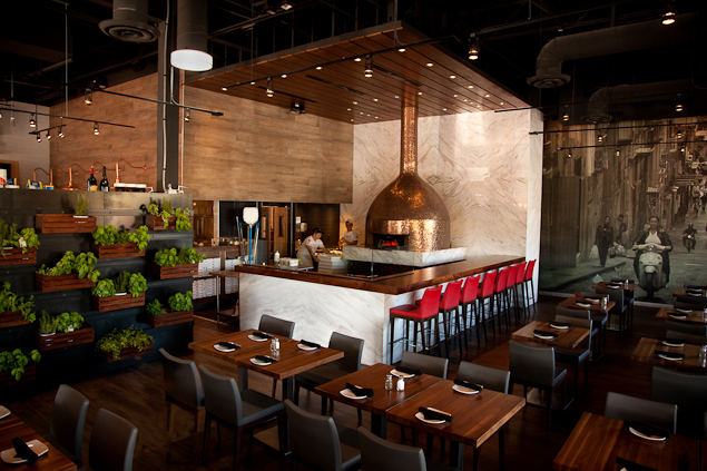 Wide view of pizza prep area at Pomo Pizzeria